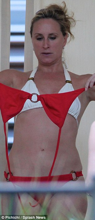 Confused: Meanwhile her co-star Sonja Morgan couldn't decide between a red and a white bikini