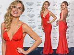 Mandatory Credit: Photo by REX Shutterstock (5411926m)\n  Kimberley Garner arrives at the Chain Of Hope Annual Ball held at the Grosvenor House.\n Chain Of Hope Annual Ball, London, Britain - 20 Nov 2015.\n \n