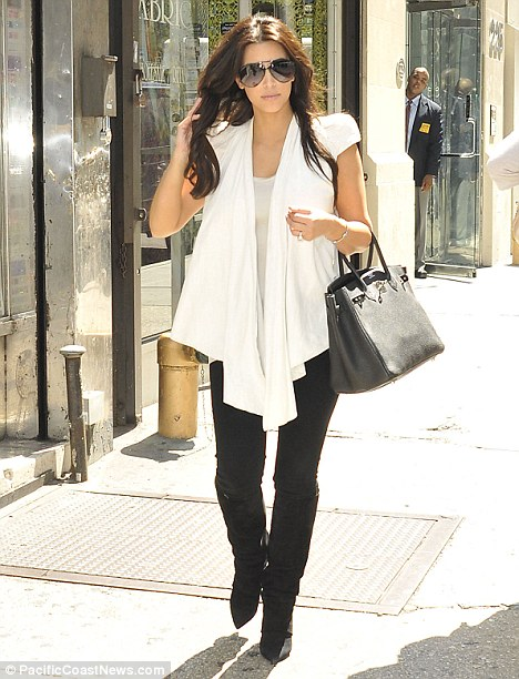 Prepping for the big day: Kim Kardashian checked on the progress of her wedding dress at Vera Wang in New York today