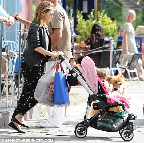 Standing out from the crowd: Rachel teamed the bottoms with a plain vest top and black jacket as she enjoyed the sunshine with her little girl
