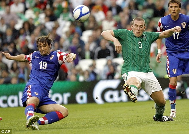 Battle: Croatia's Niko Kranjcar and Ireland's Richard Dunne fight for the ball