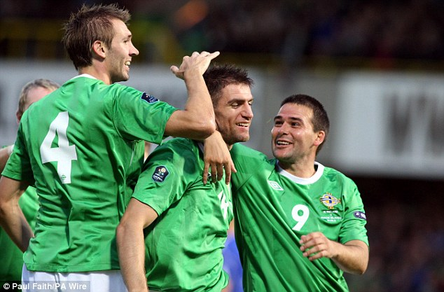 Great start: Aaron Hughes prodded home with just five minutes played