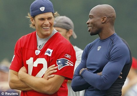 Patriot games: Chad Ochocinco, right, says New England quarterback Tom Brady, left, has helped him settle in with his new team