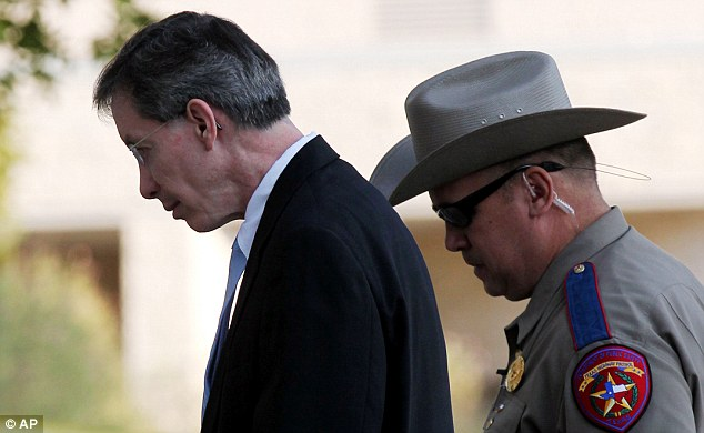 Going down: Jeffs is escorted into the Tom Green County Courthouse yesterday for sentencing