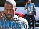 Picture Shows: Kanye West  November 19, 2015\n \n Rapper and busy dad Kanye West is spotted chatting on his cellphone at his office in Calabasas, California. Kanye was showing off a rocker look, sporting a torn Nirvana shirt. \n \n Non Exclusive\n UK RIGHTS ONLY\n \n Pictures by : FameFlynet UK © 2015\n Tel : +44 (0)20 3551 5049\n Email : info@fameflynet.uk.com