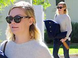 Toluca Lake, CA - Kirsten Dunst shares a smile as she leaves a friends house.  Kirsten has her hands full as she walk out carrying her coat and a gold bottle.\nAKM-GSI          November 19, 2015\nTo License These Photos, Please Contact :\nSteve Ginsburg\n(310) 505-8447\n(323) 423-9397\nsteve@akmgsi.com\nsales@akmgsi.com\nor\nMaria Buda\n(917) 242-1505\nmbuda@akmgsi.com\nginsburgspalyinc@gmail.com