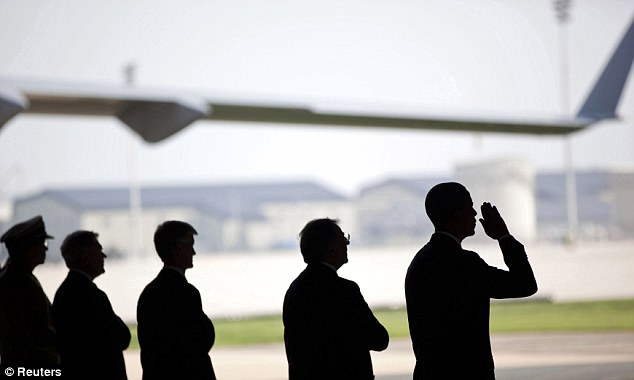 Pay respects: U.S. President Barack Obama salutes during a ceremony for the 'dignified transfer' of U.S. and Afghan personnel who died in a helicopter crash in Afghanistan