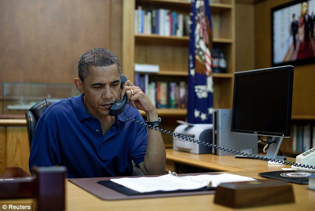 Tragic development: U.S. President Barack Obama holds a conference call from Camp David, Maryland yesterday after a NATO helicopter crashed during a battle with the Taliban in Afghanistan