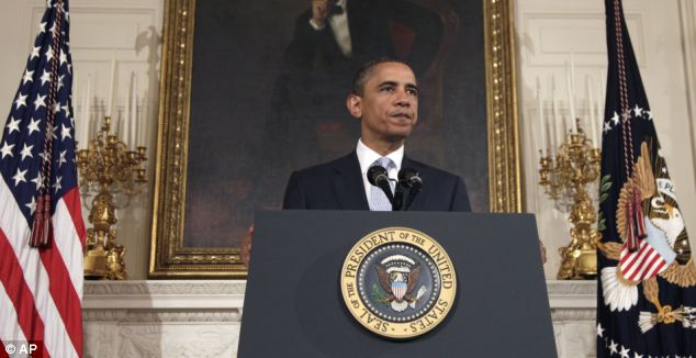 Mourning: President Barack Obama speaks about the troops' sacrifice at the White House