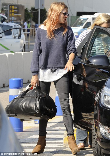 Heavy lifter: The actress was more than happy to help out with the luggage