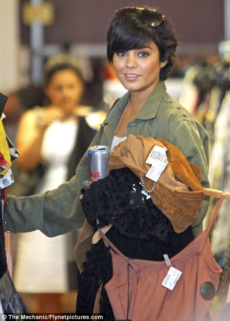 Energy boost: The 22-year-old actress was seen sipping on a can of red bull to fuel her for the shopping trip
