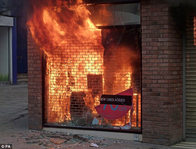 Within minutes there was a huge fire in the window of the store as rioting spread to Birmingham and Manchester on the fourth night of disturbances