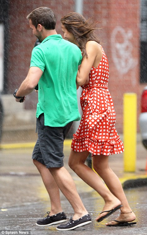 Quick! Irina Shayk and her agent dash through the rain after getting caught in a sudden downpour after lunch in New York