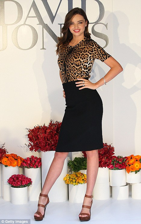 Getting on with the day job: Miranda sizzled on the catwalk as she posed at the David Jones Spring/Summer fashion preview in Melbourne