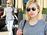 Picture Shows: Emma Roberts  November 20, 2015\n \n Actress Emma Roberts spotted leaving Barneys New York in Beverly Hills, California. Emma looked causal-cool in a grey peplum shirt and boyfriend jeans,\n \n Non Exclusive\n UK RIGHTS ONLY\n \n Pictures by : FameFlynet UK © 2015\n Tel : +44 (0)20 3551 5049\n Email : info@fameflynet.uk.com