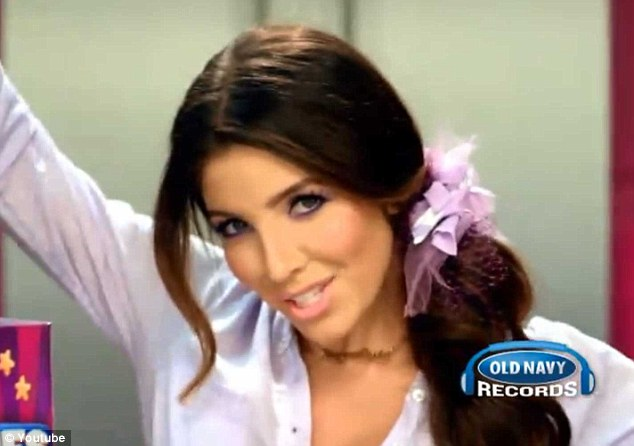 Doppelgänger: In the advertisement, Molinaro hair and make-up is styled almost identically to Kim's