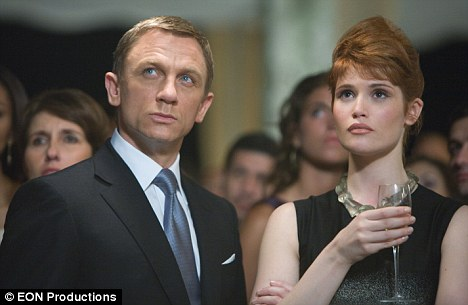 On a mission: Craig as James Bond, left, and actress Gemma Arterton as Agent Fields, right, infiltrate a fundraising party in Bolivia in Quantum of Solace