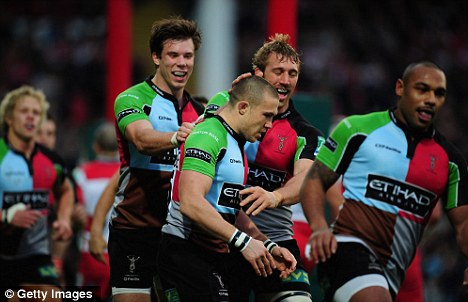 Twelve unbeaten: Brown (centre) is congratulated  after his try