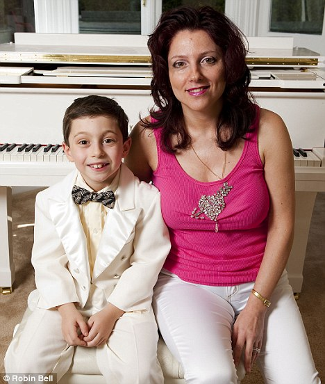 Missed out: Curtis, pictured with mum Hayley, was told by Louis Walsh at the auditions that he was 'really going somewhere'