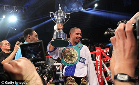 Super slick: Andre Ward celebrates defeating Carl Froch and winning the Super Six tournament