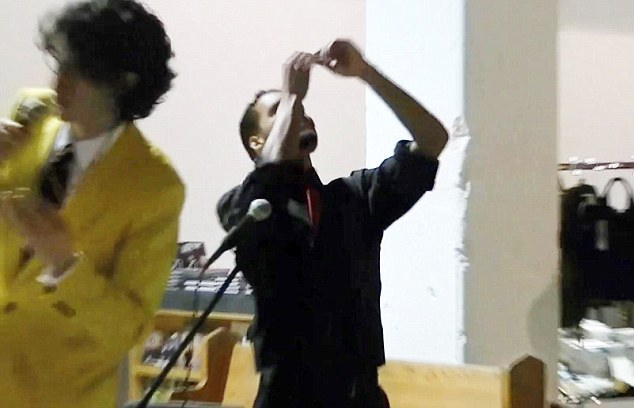 Rejoicing: A jubilant Mr Williams throws his hands in the air after completing the record breaking bid