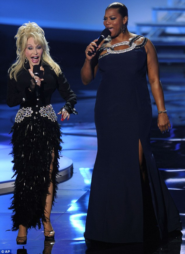 Diva duet: Dolly changed into this fringed frock as she took to the stage to perform with Queen Latifah at last night's event