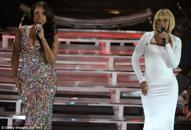 Flaunting their figures: Much like Jennifer, Mary slipped her curves into a figure-hugging dress to sing