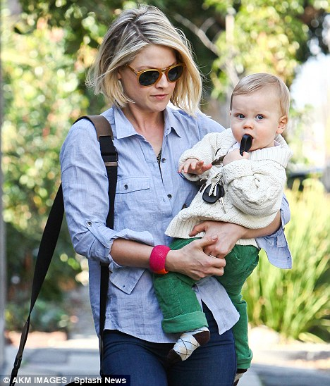 Yummy: Two days before he has his first birthday, Ali Larter's son chews away on her car keys as she takes him to a play date in sunny Los Angeles