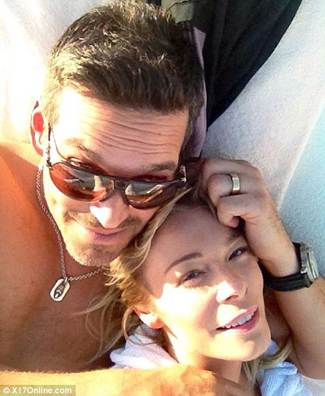 Newlyweds: Rimes tweeted pictures of her and new husband Eddie Cibrian looking suitably loved up as they relaxed in the sunshine