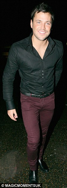 Someone looks pleased with himself: Mark looked in good spirits as he and his ex got out of their taxi