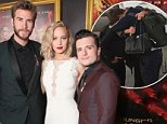 """LOS ANGELES, CA - NOVEMBER 16:  (L-R) Actors Liam Hemsworth, Jennifer Lawrence and Josh Hutcherson attend premiere of Lionsgate's """"The Hunger Games: Mockingjay - Part 2"""" at Microsoft Theater on November 16, 2015 in Los Angeles, California.  (Photo by Todd Williamson/Getty Images)"""