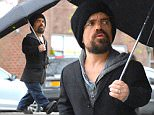 NEW YORK, NY - NOVEMBER 19:  Actor Peter Dinklage is seen walking in the rain in Soho on November 19, 2015 in New York City.  (Photo by Raymond Hall/GC Images)