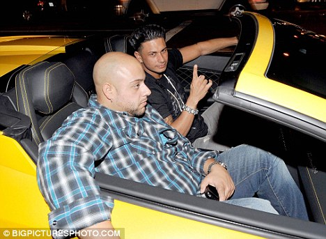 Just cruisin': With his bodyguard in tow, the pair cruise around the streets in the luxury car