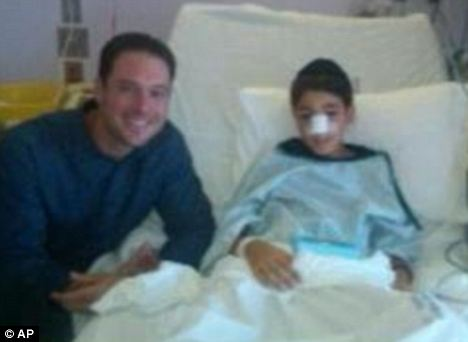 Apology: Dobbs, whose line-drive smashed the boy in the face, visited him in hospital