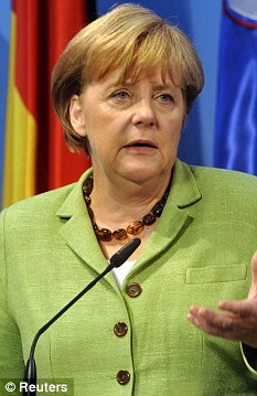 Powerhouse: German Chancellor Angela Merkel insists her country will continue to back the euro
