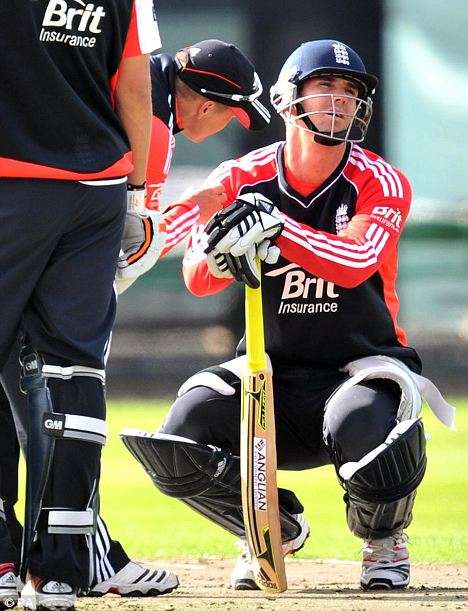 Pain in the neck: Pietersen with coach Andy Flower after being struck by a delivery from Broad