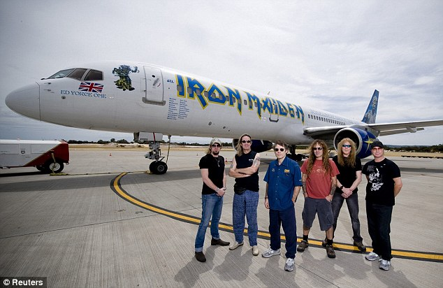 Flying high: World famous rockers Iron Maiden pose for a photograph next to Ed Force One