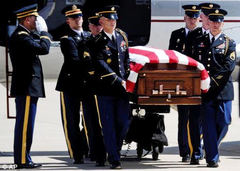 Coming home: A casket is removed from a plane at Buckley Air Force Base in Aurora, Colorado. With one day left in August, the U.S. death toll has reached 66