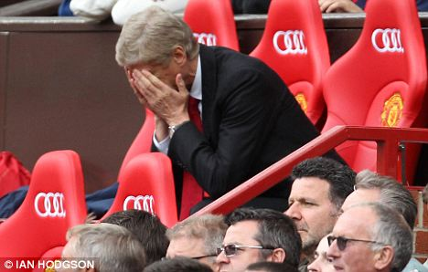 Depressing day: Arsenal manager Arsene Wenger shows the strain at Old Trafford on Sunday