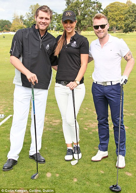Teed off: Earlier that day, the couple were in slacks and golf shoes as they joined Ronan Keating at a charity golf tournament