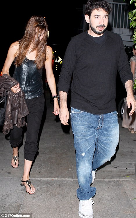 Two is company: Jordan Bratman leads his date to his car in Santa Monica last night