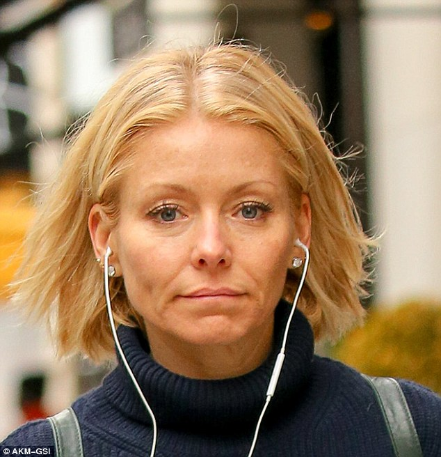 Fresh faced: Kelly Ripa removed her TV make-up for a solo stroll in New York on Thursday
