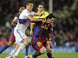 """Barcelona's Argentinian forward Lionel Messi (R) vies for the ball with Real Madrid's Portuguese forward Cristiano Ronaldo during the Spanish league """"clasico"""" football match FC Barcelona vs Real Madrid on November 29, 2010 at Camp Nou stadium in Barcelona. Barcelona won 5-0.   AFP PHOTO/ JOSEP LAGO (Photo credit should read JOSEP LAGO/AFP/Getty Images)"""