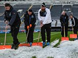NEWCASTLE, ENGLAND - NOVEMBER 21:  Newcastle United groundsmen shovel ice off the pitch prior to the Barclays Premier League match between Newcastle United and Leicester City at St.James' Park on November 21, 2015, in Newcastle upon Tyne, England. (Photo by Serena Taylor/Newcastle United via Getty Images)