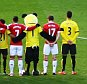 WATFORD, ENGLAND - NOVEMBER 21: Players from both teams line up for the French national anthem to remember the victims of the terror attacks in Paris last week prior to the Barclays Premier League match between Watford and Manchester United at Vicarage Road on November 21, 2015 in Watford, England.  (Photo by Richard Heathcote/Getty Images)