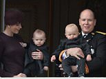 MONACO - NOVEMBER 19:  Princess Charlene of Monaco with Princess Gabriela and Prince Albert II of Monaco with Prince Jacques greet the crowd from the palace's balcony during the Monaco National Day Celebrations on November 19, 2015 in Monaco, Monaco.  (Photo by Pascal Le Segretain/Getty Images)