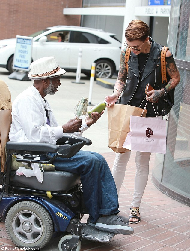 You smoothie: The Australian model joked with the wheelchair-bound gentleman - who was collecting dollars in the street