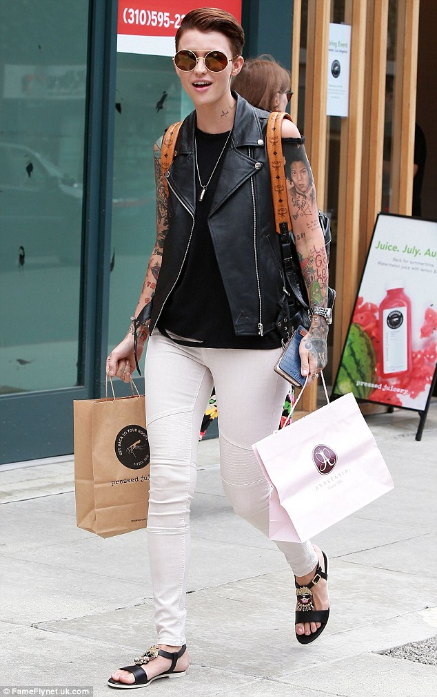 Edgy style: Her leather waist coat made the most of her colourful arm art - displaying some of her over 60 tats - including one of Leonardo from the Teenage Mutant Ninja Turtles