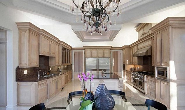 The home comes complete with a large kitchen with full appliances big enough for the Liverpool captain, his wife and three daughters