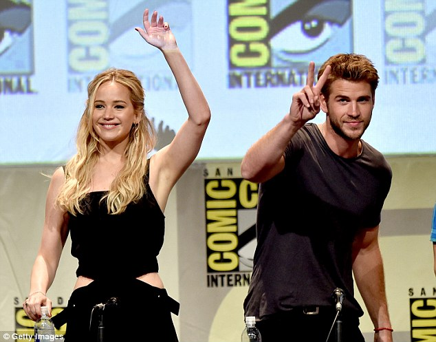 Relaxed: Jennifer's co-star Liam looked laid-back in a fitted brown T-shirt and dark wash jeans